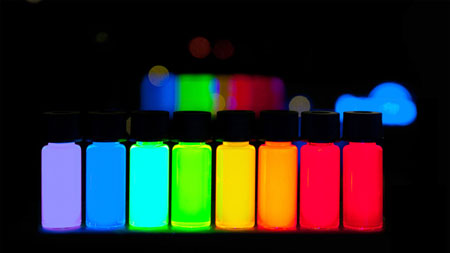 Vials of quantum dots producing vivid colors from violet to deep red