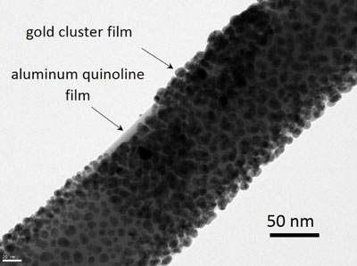 Transmission electron microscope (HRTEM) image of a GaAs-AlGaAs core-shell nanowire coated with nominally 10 nm aluminum quinoline and a 5 to 10 nm thick gold cluster film on top