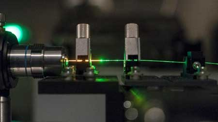 Glass Anderson Localized Optical Fiber