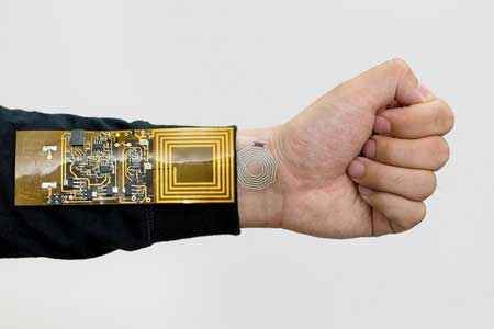 rubber sticker attached to the wrist can bend and stretch as the person's skin moves, beaming pulse readings to a receiver clipped to the person's clothing