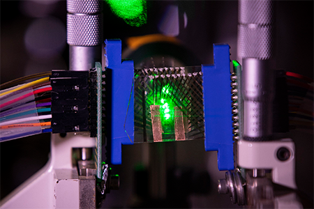 A green laser beam is focused onto a graphene-based transparent photodetector array
