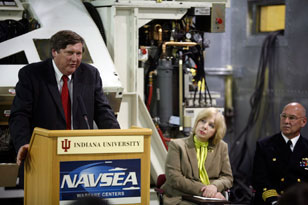 Paul Sokol, left, IU Provost Karen Hanson and Crane commander Captain Charles LaSota