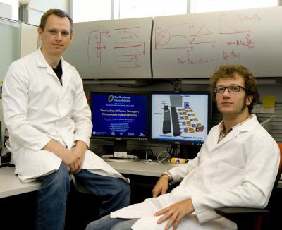UT nano scientists Arturas Ziemys, Ph.D., left, and Alessandro Grattoni are readying an experiment that will be tested in space