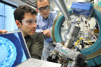 University of Chicago scientist Rafael Jaramillo and Argonne scientist Yejun Feng examine the element chromium at the Advanced Photon Source. Studying simple metallic chromium, the joint UC-Argonne team has discovered a pressure-driven quantum critical regime and has achieved the first direct measurement of a