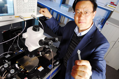 >Regents' professor Zhong Lin Wang with equipment used to measure output from his nanogenerators.