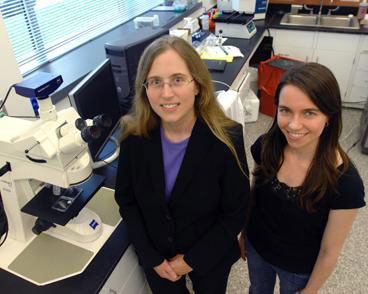 Carol Livermore, associate professor of mechanical engineering, left, stands with graduate student Frances Hill in Livermore's lab