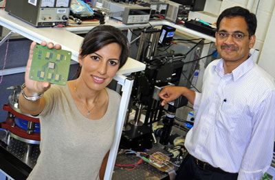 Purdue University doctoral student Tannaz Harirchian holds up special chips provided by Delphi Electronics and Safety that she and Professor Suresh Garimella used to simulate what happens in a real chip