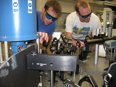 Alex High and Aaron Hammack adjust the optics in their UCSD lab.
