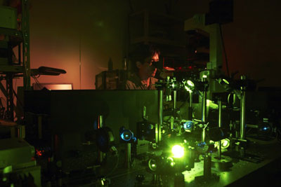 A prototype microscope system. Kenji Okamoto of the Cellular Informatics Laboratory demonstrates the experiment to test the performance of a prototype detector attached to a high-end optical microscope