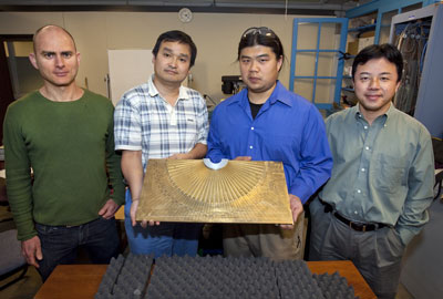 Berkeley researchers (from left) Guy Bartal, Xiaobo Yin, Lee Fok and Xiang Zhang shown with their acoustic hyperlens which boosts the magnification of sound-based imaging technologies such as ultrasound and underwater sonar by eightfold