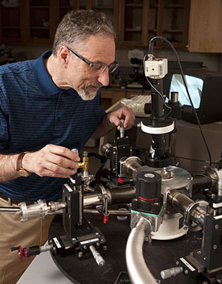 In his Johns Hopkins materials science lab, Howard E. Katz adjusts probes used for testing electronic devices