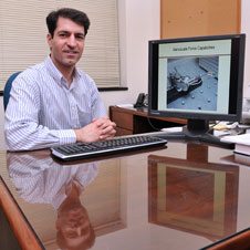 Associate mechanical and industrial enginnering professor Nader Jalili displays an image of a nanorobot on his office computer