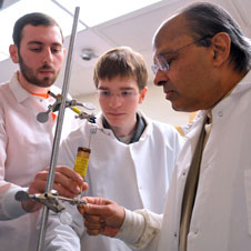 Professor Sridhar, left, working with undergraduate student researchers Craig Levy and Evan Jost.