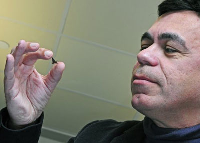Babak Ziaie, a professor of electrical and computer engineering and biomedical engineering, holds a miniature birdlike shape made from ferropaper