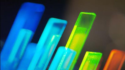 Phosphorescent emitter materials for organic light-emitting diodes (OLED) are tested under UV light
