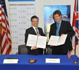 CNSI director Paul Weiss (left) and NSQI director Daniel Robert at the UCLA signing ceremony