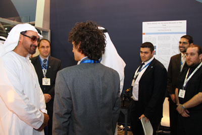 Dr. Matteo Chiesa (foreground) and Asylum Research's Mick Phillips (right) discuss AFM solar energy applications with visitors to the MASDAR LENS booth, including His Highness General Sheikh Mohamed bin Zayed Al Nahyan, Crown Prince of Abu Dhabi