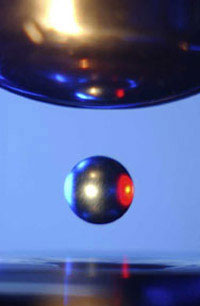Solid sample hovers in space in NASA�s electrostatic levitation chamber