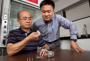 Junhong Chen, UWM associate professor of mechanical engineering (right), is commercializing his nanotechnology research.