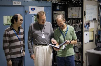 Researchers including Hirohito Ogasawara (left), Anders Nilsson (center), and Mike Toney (right) used the bright X-ray beam at SLAC's Stanford Synchrotron Radiation Lightsource to study a new form of platinum that could be used to make cheaper, more efficient fuel cells.