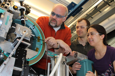 Thomas Proffen, left, of Los Alamos National Laboratory, and Peter Chupas and Karena Chapman of Argonne National Laboratory examine the high-energy X-ray beamline 11-ID-B at Argonne's Advanced Photon Source facility