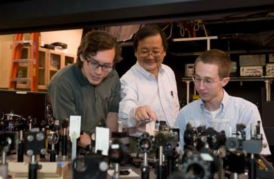 Washington State University chemist Choong-Shik Yoo, seen here with students, has used super-high pressures to create a compact, never-before-seen material capable of storing vast amounts of energy