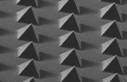Image of Advanced Diamond Technologies' highly repeatable, wafer scale, 3D diamond structures available in different structure heights and pitches for engineered CMP pad conditioners. Shown are all-diamond pyramids, six microns wide at the base