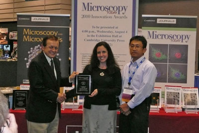 Dr. Charles Lyman, editor of Microscopy Today magazine, presents MT-10 Award to Donna Guarrera (JEOL USA, Peabody, Mass.), Product Manager, and Hidetoshi Nishiyama (JEOL Ltd., Akishima, Japan), Co-Developer of the JEOL ClairScope Atmospheric Scanning Electron Microscope.