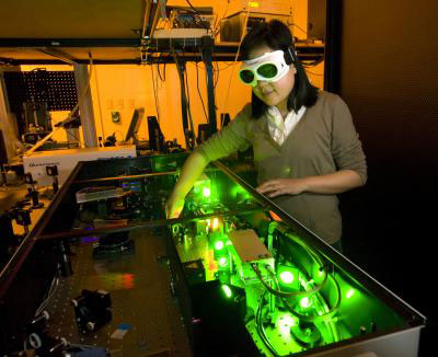Purdue mechanical engineering doctoral student Yaguo Wang works with a high-speed laser