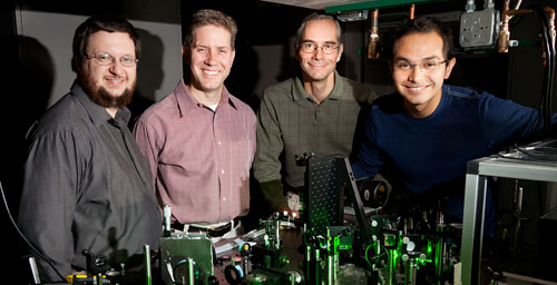 From left, Eric Chaney, a research specialist at the Beckman Institute; Stephen Boppart, a professor of electrical and computer engineering, of bioengineering and of medicine; Martin Gruebele, a professor of chemistry and of physics; and Wladamir Benalcazar, a graduate fellow at the Beckman Institute
