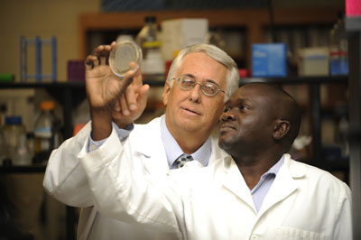 Valery Petrenko (left), principal investigator of Auburn's Center for Translational Cancer Nanomedicine, is shown with researcher Olusegun Fagbohun.