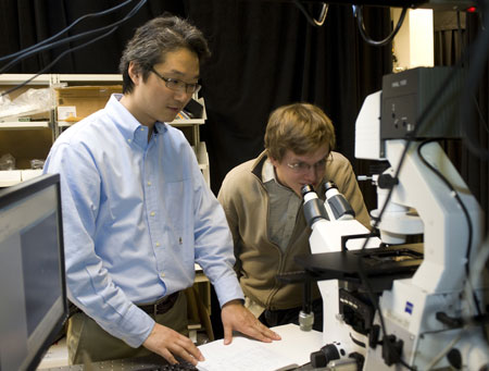Jong Hyun Choi, an assistant professor of mechanical engineering at Purdue, and doctoral student Benjamin Baker use fluorescent imaging to view a carbon nanotube