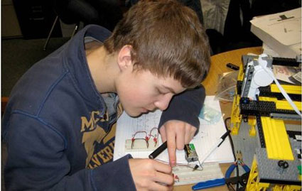 Chassell High School student Jared Jarvi working on the wiring of a 'bread board' for a light sensor array