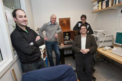 Joshua Rosenberg, manager of the University's microscopy imaging facility, Professor of Physics Krzysztof Kempa, Greg McMahon, a researcher and nanolithography specialist in the University's Clean Room Nanofabrication Facility, and Ferris Professor of Physics Michael J. Naughton