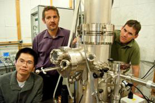 Jiamin Xue, Philippe Jacquod and Brian LeRoy (left to right) with the scanning tunneling microscope they use to study graphene
