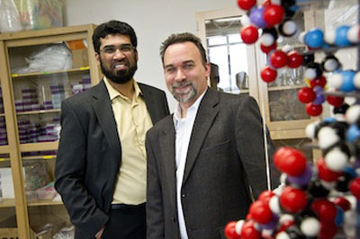 Samir Iqbal (left) electrical engineering assistant professor, and Shawn Christensen, assistant professor in biology