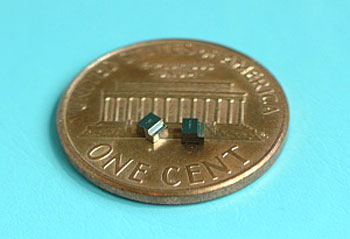 Two miniature magnetic switches on a US one-cent piece