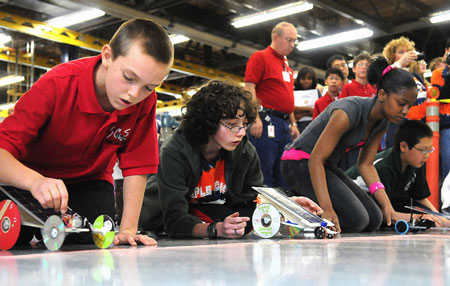 Middle school students from the Chicago area prepare to race their model solar/battery-powered cars