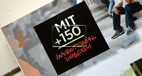 A prototype of the MIT researchers' transparent solar cell is seen on top of a promotional item for MIT's 150th anniversary celebrations