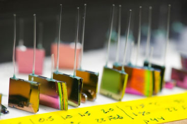 A variety of silicon chip micro-reactors developed by MIT