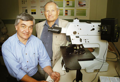 Professor Andrei Rode in the lab with colleague Dr Eugine Gamaly