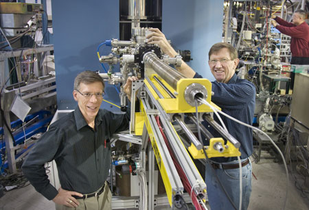 Dan Fischer (left) and Raymond Browning show off the prototype of the Vector Potential Photoelectron Microscope