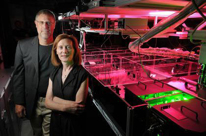 CU-Boulder physics professors and JILA fellows Henry Kapteyn and Margaret Murnane stand next to one of their laser devices