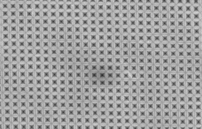 a sheet of silicon has been textured with an array of tiny inverted-pyramid shapes