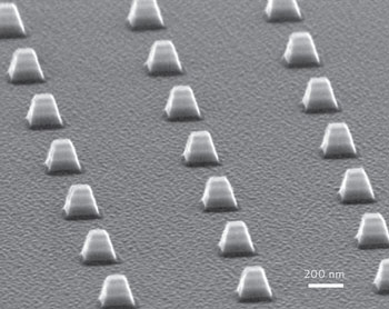 Electron micrograph showing arrays of indefinite optical cavities comprised of silver/germanium multilayers