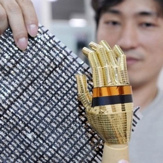 Tsuyoshi Sekitani displays an elastic sheet containing carbon nano tubes which conduct electricity