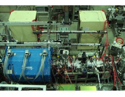 The superconducting solenoid (lower left in blue) contains the multi-ring trap for catching and cooling antiprotons and the beamline (lower right) transports ultra-slow antiproton beams to the collision chamber