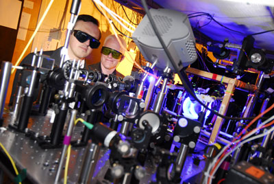 Associate professor Alex Kuzmich (left) and research scientist Stewart Jenkins, both of the Georgia Tech School of Physics, adjust optical equipment used to study quantum memory.