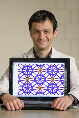 Dr. Artem Oganov shows the crystal structure of the new phase of boron