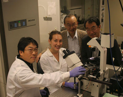 From L to R, Brian Seunghan Oh, a materials science postdoc in the Jacobs School's Department of Mechanical & Aerospace Engineering; Karla Brammer, a Jacobs School materials science graduate student; Jacobs School bioengineering professor Shu Chien; and materials science professor Sungho Jin.